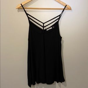 A Black Dex tank top with a strappy front.